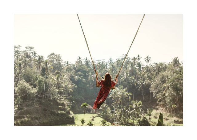 Woman swing out into the jungle